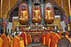 Buddhist Monks worshiping in the temple at Mt. Jiuhua