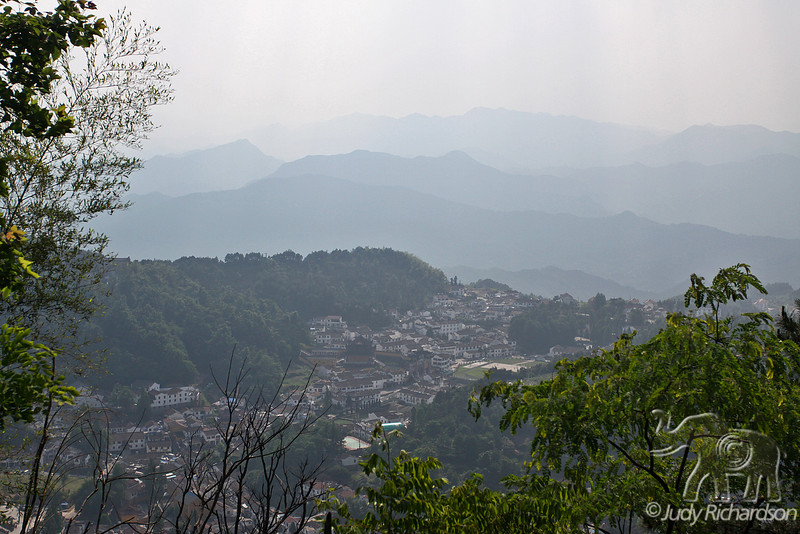 Hazy view of mountains and village surrounding Mt. Jiuhua