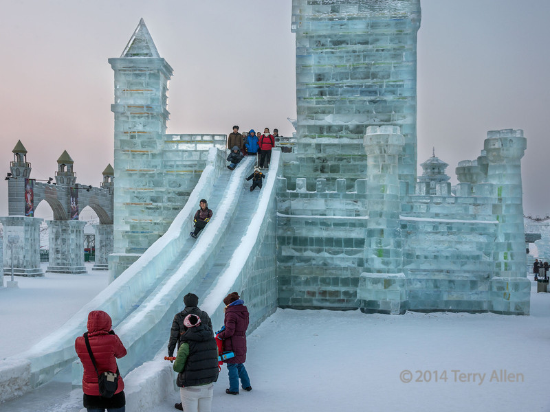 Ice slides at the Ice Festival, Harbin, China<br /> <br /> A number of the ice structures have ice slides, which seems to be a popular activity.