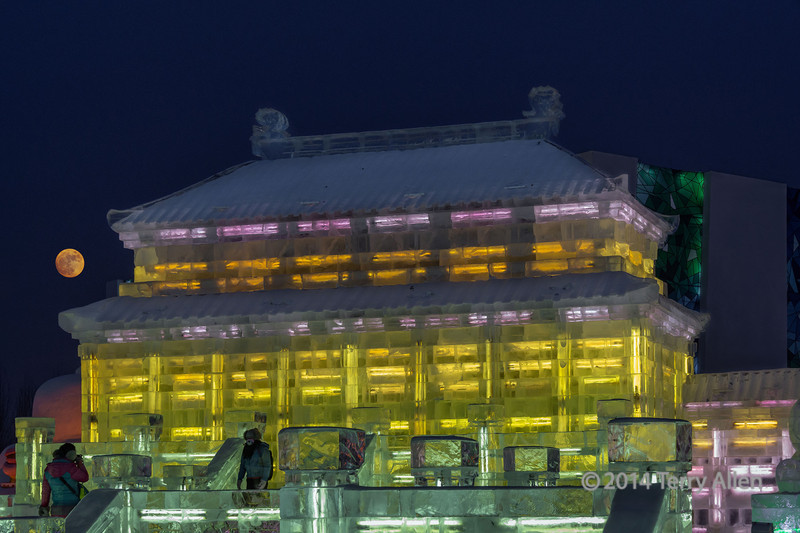 Chinese ice temple lit up at night, Harbin Ice Festival,China