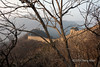 View through the trees to the Mutianyu Great Wall at sunset, China<br /> <br /> I used a high f-stop and a tripod to capture this peek at the Great Wall through the trees and keep the entire view field in focus.
