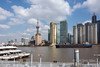 Pudong-skyline-and-freighter-on-the-Huangpu-River,-Shanghai,-China-