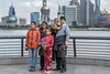 Tibetan-family-on-the-promenade,-Shanghai,-China