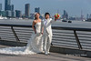 Wedding-couple-having-their-photographs-taken-on-the-Shangahi-promenade,-China