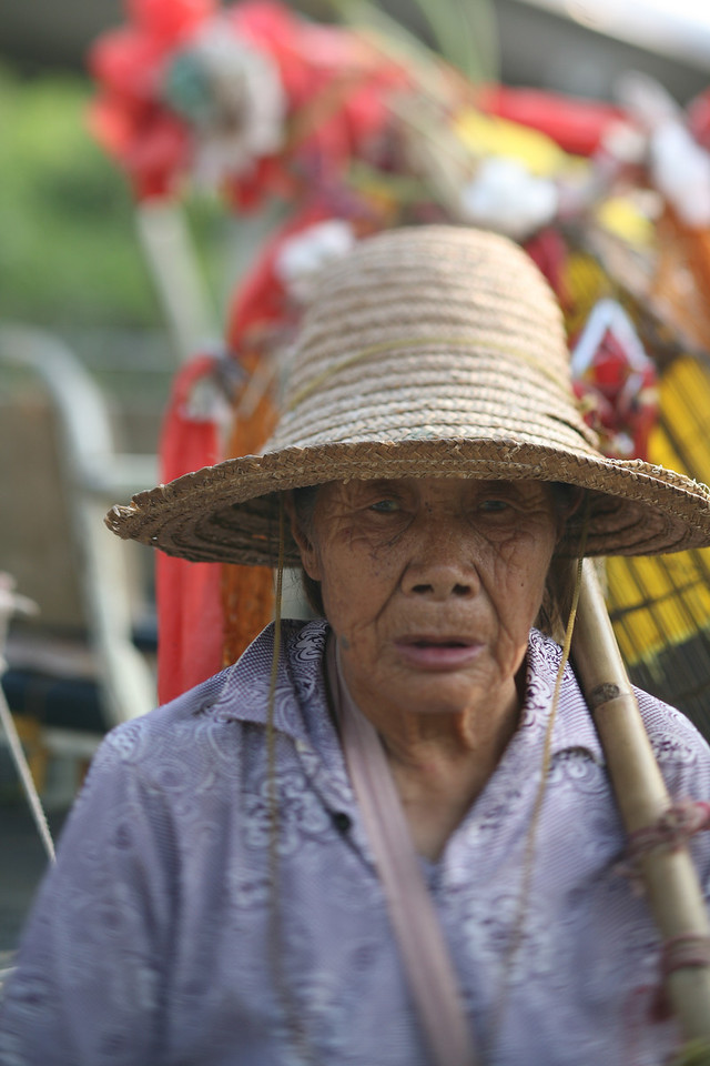 Woman with Flowers, Yang Shuo, China<br /> Another woman with her tourist props.