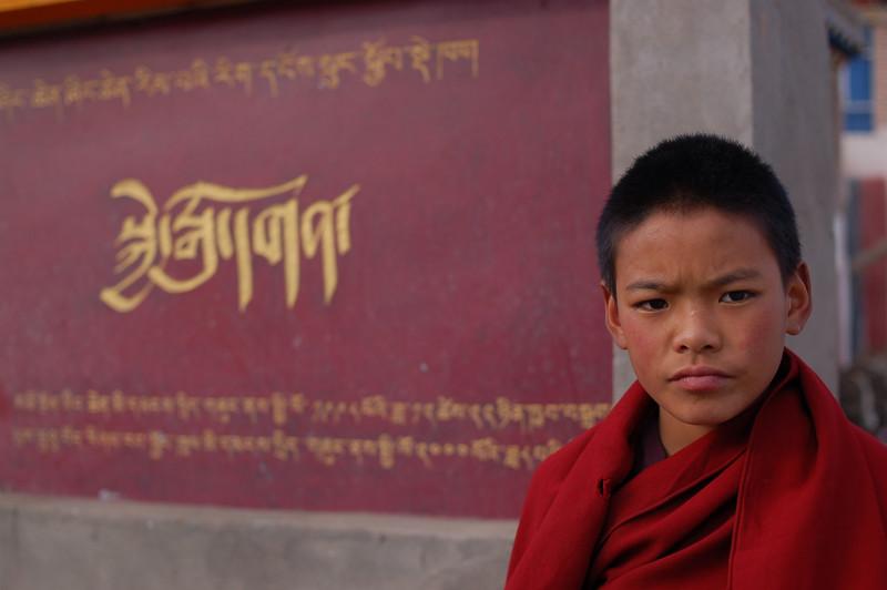 Serious novice monk outside the Jyekundo Dongdrubling Monastery