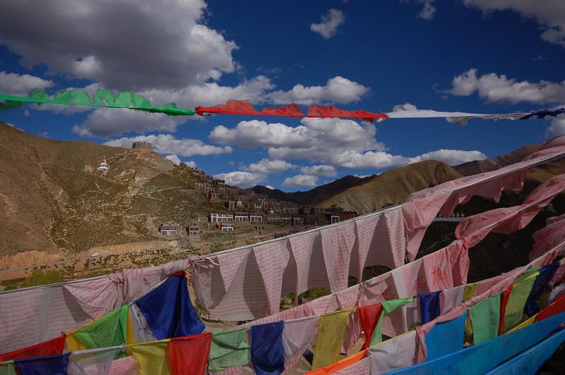 Prayer flags blocking the view of the Jyekundo Dongdrubling Monastery
