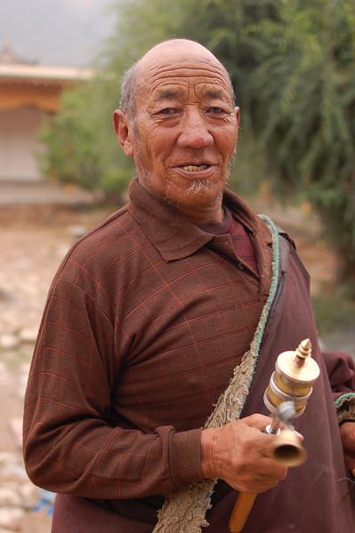 An old pilgrim doing his morning kora