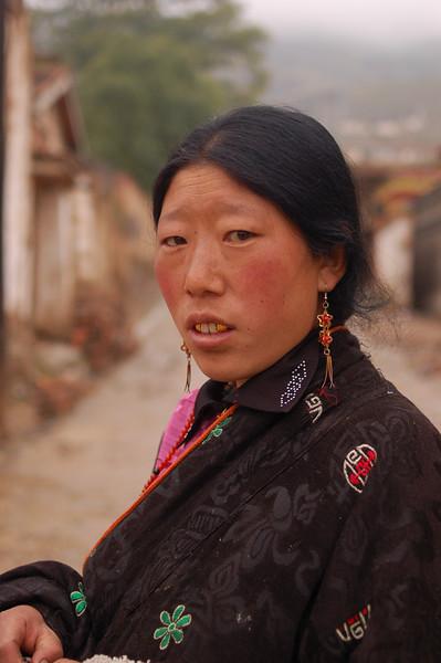 Young Tibetan woman starting her morning kora