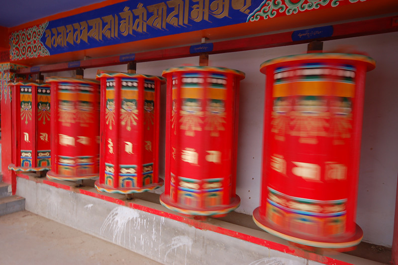 Bright new prayer wheels of the Rongwo Gonchen Gompa