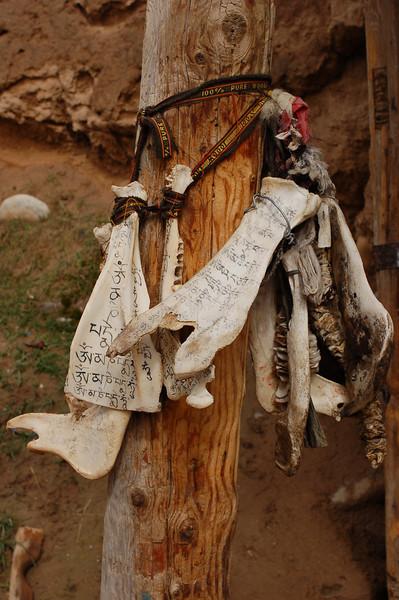 Prayers on yak bones outside the Gomar Gompa