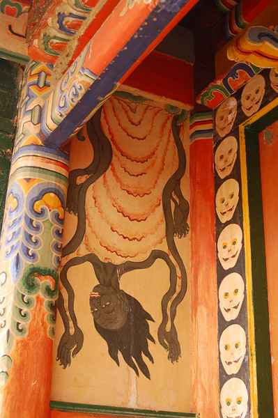Some frightening wall paintings outside a temple