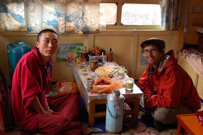 Yann and Luocang, a thangka painter at the Upper Wutun Monastery