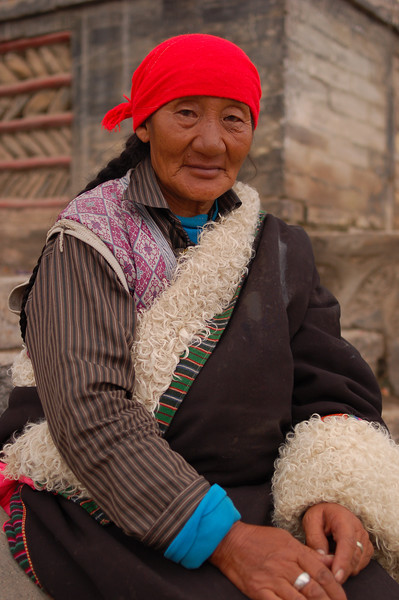 Tibetan pilgrim outside the monastery.
