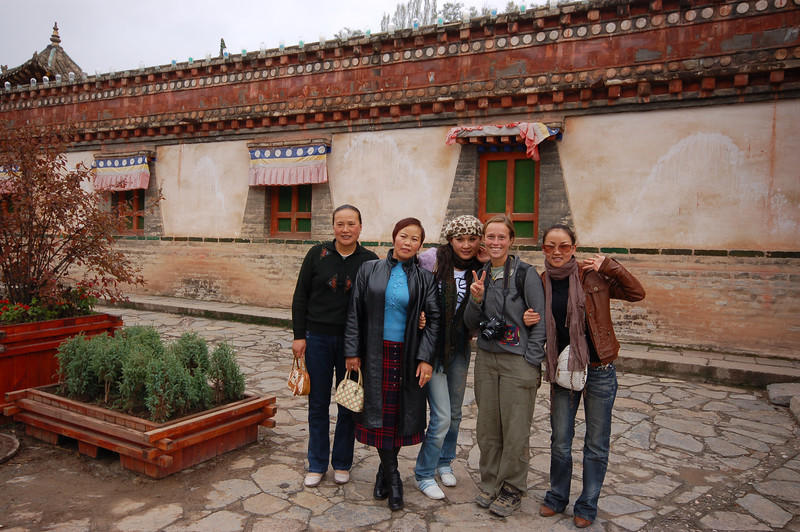 Emilie invited to pose with Chinese tourists.
