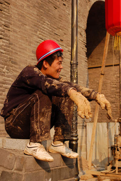 A construction worker enjoys the Imperial China performance