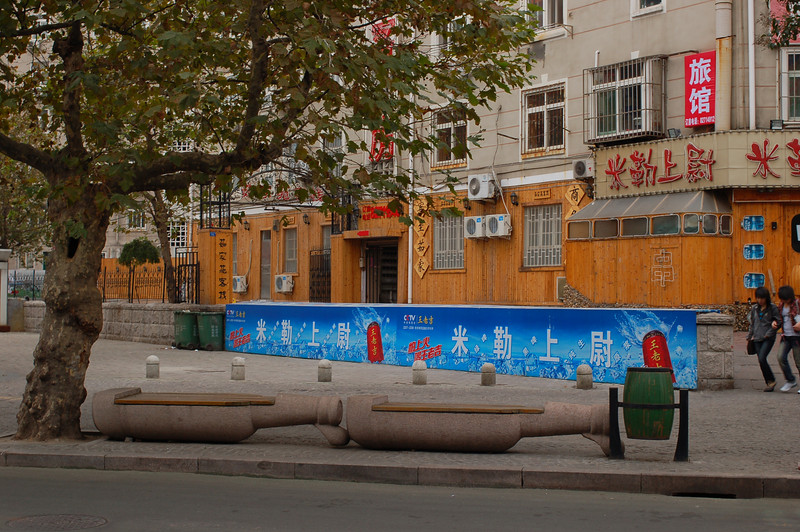 Beer bottle benches line the streets outside the Tsingtao Brewery