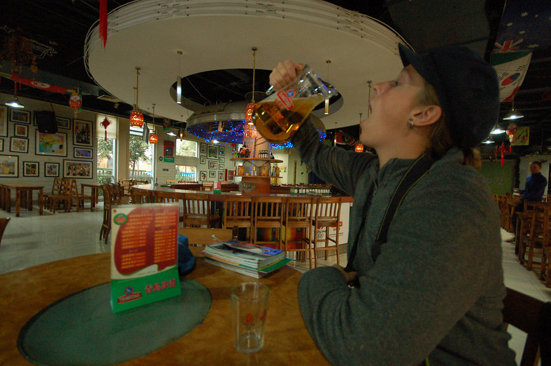 Emilie enjoying her complimentary pitcher of Tsingtao beer, a la Megan style.