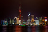 The Shanghai, China skyline at night with the Huapong River in the foreground.