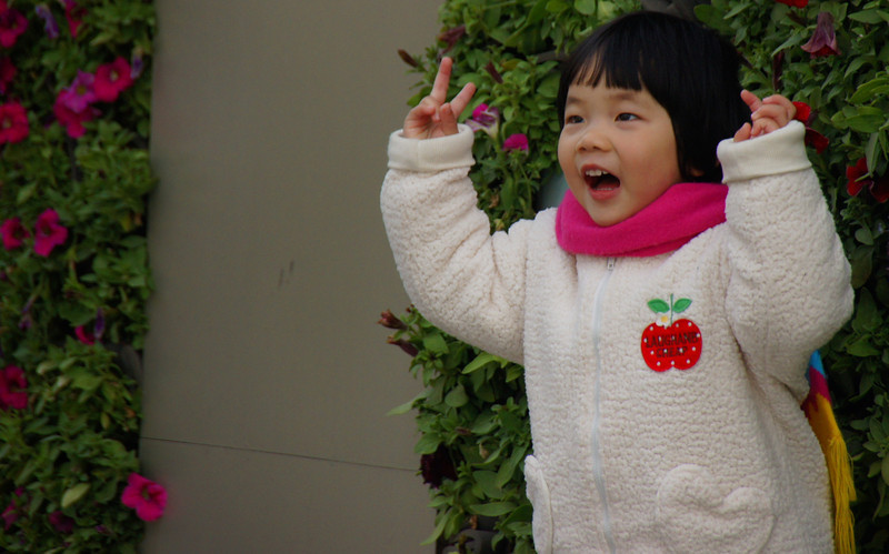 """An excited little girl poses for the camera - Shanghai, China.  A travel photo near the Bund - Shanghai, China. <a href=""""http://nomadicsamuel.com"""">http://nomadicsamuel.com</a>"""