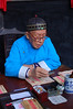 An old calligrapher in the Rinshengchang Bank Museum (China's first bank)