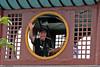Alan waving from next to top floor of Shibaozhai Pagoda