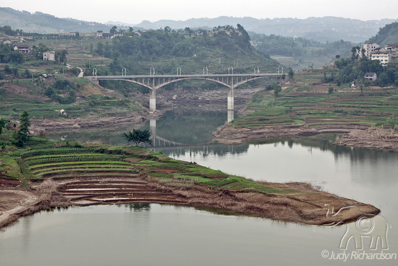 Rice and vegetable terraces with bridge from top of Shibaozhai Pagoda