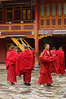 Monks leave prayer hall, Nanhu Monastery