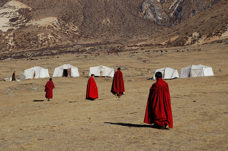 Young monks return to their tents