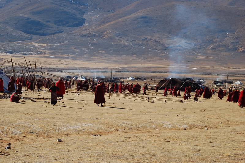 Monks leave the prayer tent