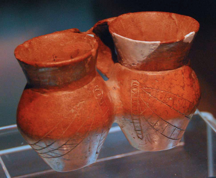 These twin cups, about 4 inches high, with a silk-worm design are from the Qijia Culture, 2100-1700 BC.  Gansu Provincial Museum, Lanzhou.