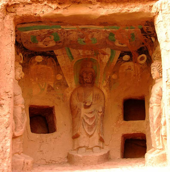 The Bingling Grottos are a couple of hours drive and a boat ride up the Yellow River, southwest of Lanzhou.  At the Bingling Grottes a few of the grottos can be seen (and thus photographed) from outside.  Here is a small grotto, about 6 feet by 6.