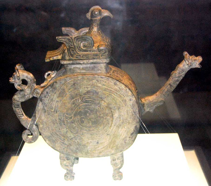 This is a bronze tea pot with dragon handle and spout and a phoenix lid.  Western Zhou Dynasty, 1000-900 BC. Shaanxi Provincial Museum, Xi'an.