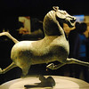 "This famous bronze ""Flying Horse of Gansu,"" excavated from a Han Dynasty general's tomb from 25-200 AD, is one of the great treasures of Chinese--indeed world--art.  The horse balances perfectly on one leg and has an almost lifelike quality.  It is about 1 foot high.  Gansu Provincial Museum, Lanzhou."
