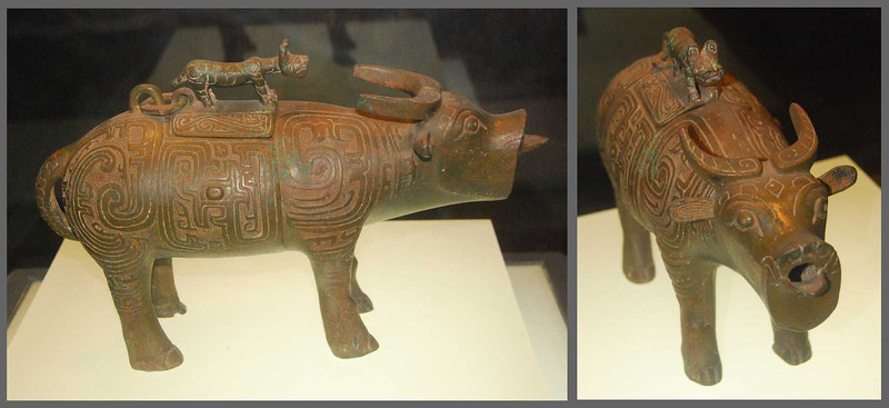 The Zhou Dynasty (1027-256 BC) is known for its bronze ware.  This is a bronze wine jug in the shape of an ox with a tiger lid handle; 15 inches long.  You pour the wine out of the ox's mouth.  Western Zhou Dynasty, 1000-900 BC.  Shaanxi Provincial Museum, Xi'an.