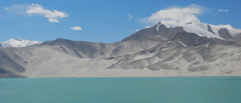 We passed this lake at an elevation of about 10,000 feet.   The mountain on the far side had a huge sand dune as well as a glacier.  I've never seen anything like this.