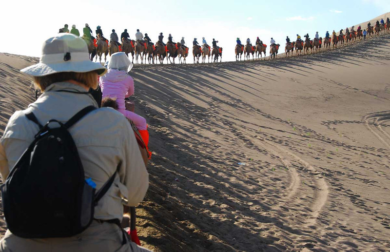 Here we are heading up a sand dune.  The Chinese all rented orange boots to keep the sand out of their shoes.  I'm sure Marco and Xuanzang did the same.