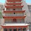 Behind this nine-story facade at Mogao is a 117 foot high Maitreya Buddha, made of painted plaster over a sandstone carving.  This is now the 2nd largest stone Buddha in the world, after the previous 2nd and 3rd largest at Bamiyan were destroyed by the Taliban in 2001.