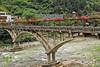 Flower trellis covering walkway and bridge to Snow Jade Cave