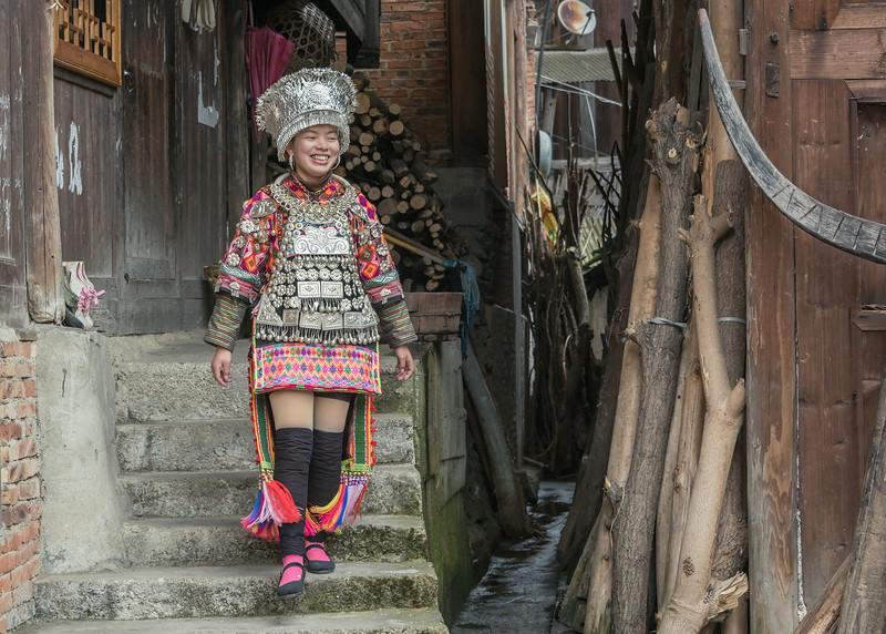 Short-skirt-Miao-woman-in-traditional-attire,-Datang-Village,-Guizhou-Province,-China