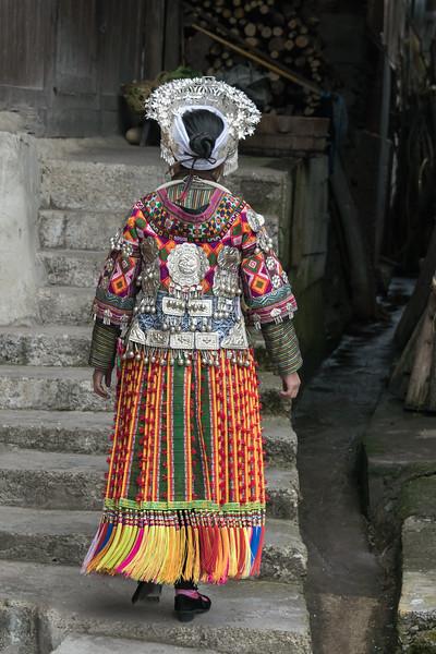 Short-skirt-Miao-woman,-rear-view,-Datang-Village,-Guizhou-Province,-China