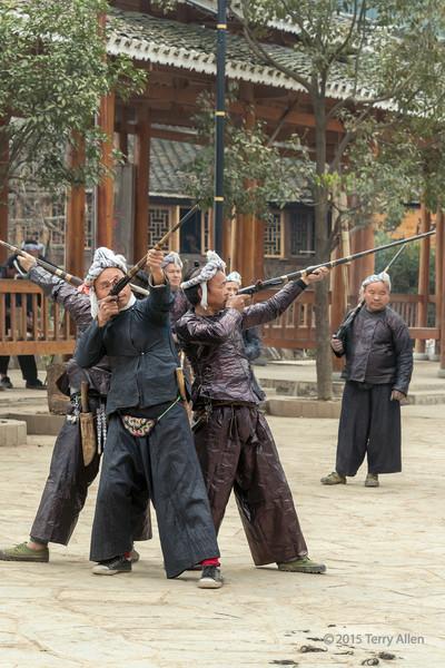 Basha Miao men perfoming a gun dance, Basha Miao Village, Guizhou Province, China