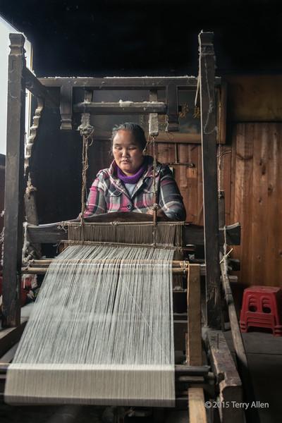 Basha Miao woman weaving unbleached cotton to make traditional clothing, Basha Gun Village, Guizhou Province, China