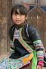 Basha Miao girl in traditional attire, Basha Miao Village, Guizhou Province, China.
