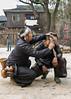 Watch the ear!<br /> <br /> Beginning of a ritual hair cut leaving a topknot. Basha Miao Village, Guizhou Province, China.
