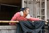 Miao girl working with home woven traditional cotton cloth, Basha Miao village, Guizhou Province, China