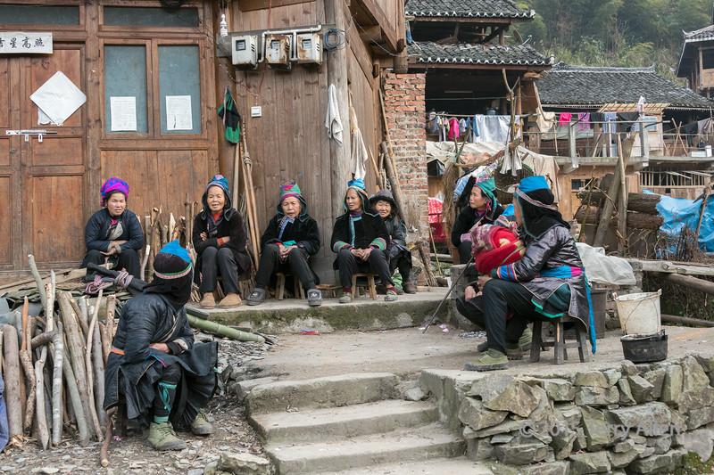 Gathering of older women, Huanggang Dong Village, Guizhou Province, China
