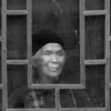 "Old woman, dirty window, cold day BW<br /> <br /> You can see how the lower part of the central panel is starting to get fogged up by her breath on a cold drizzly day.  Shiqiao Miao Village, Guizhou Province, China<br /> <br /> The colour version can be seen here (which do you prefer?), as well as some images of women in traditional attire: <a href=""http://goo.gl/PxfxR7"">http://goo.gl/PxfxR7</a>"