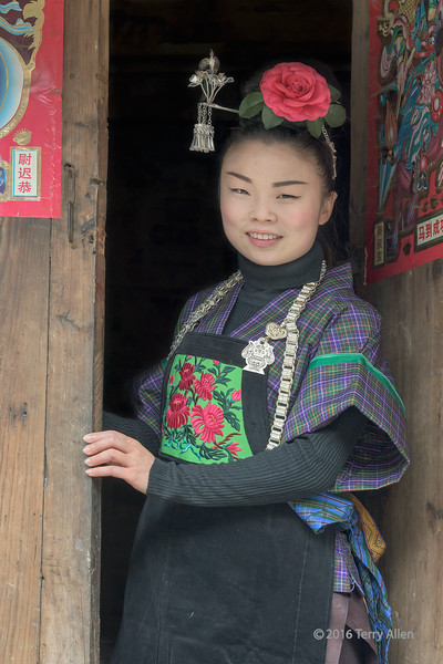 """Smiling Miao girl<br /> <br /> Young girl belonging to the Green Medium Skirt Miao ethnic minority in traditional attire.  Shiqiao Miao Village, Guizhou Province, China<br /> <br /> 06/09/15  <a href=""""http://www.allenfotowild.com"""">http://www.allenfotowild.com</a>"""