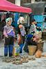 Women-selling-giner-root,-Shencun-Market,-Yangyang,-Yunnan-Province,-China